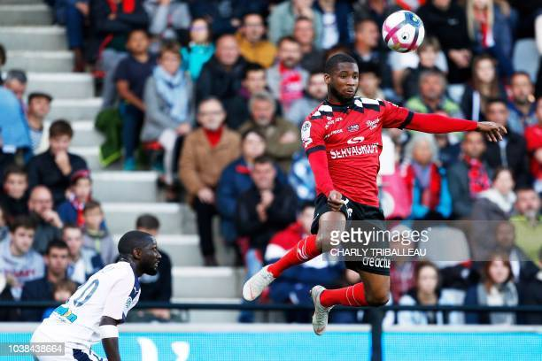 Guingamp's French defender Marcus Coco jumps for the ball next to Bordeaux's French defender Youssouf Sabaly during the French L1 football match...