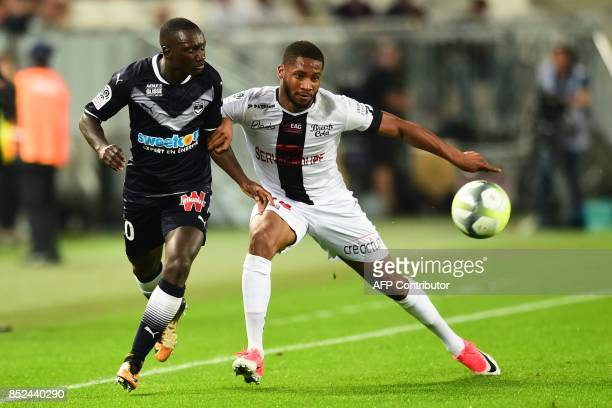 Guingamp's French defender Marcus Coco vies with Bordeaux's French defender Youssouf Sabaly during the French Ligue 1 football match between Bordeaux...