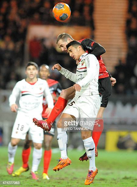 Guingamp's French defender Reynald Lemaitre vies with Nice's Algerian forward Mohamed Benrahma during the French L1 football match Guingamp vs Nice...
