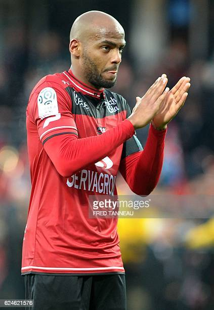 Guingamp's French forward Jimmy Briand celebrates after scoring during the French L1 football match between Guingamp and Bordeaux at the Roudourou...