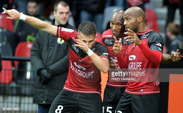 Guingamp's French forward Jimmy Briand celebrates with Guingamp's French defender Lucas Deaux after he scored a goal during the French L1 football...