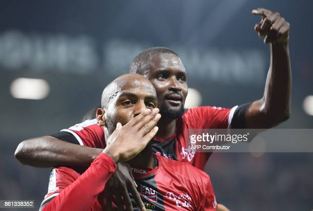 Guingamp's French forward Jimmy Briand celebrates with Guingamp's Senegalese midfielder Moustapha Diallo after scoring during the French Ligue 1...