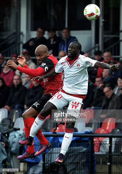 Guingamp's French forward Jimmy Briand heads the ball with Bordeaux's French defender Youssouf Sabaly during the French L1 football match between...