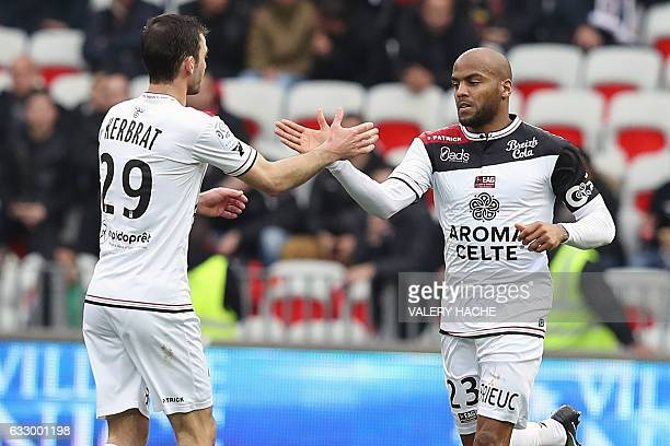 Guingamp's French forward Jimmy Briand is congratulated by Guingamp's French defender Christophe Kerbrat after scoring a goal during the French L1...