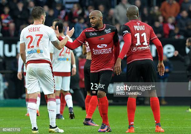 Guingamp's French forward Jimmy Briand shakes hands with Bordeaux's French midfielder Gregory Sertic after Guingamp won the French L1 football match...