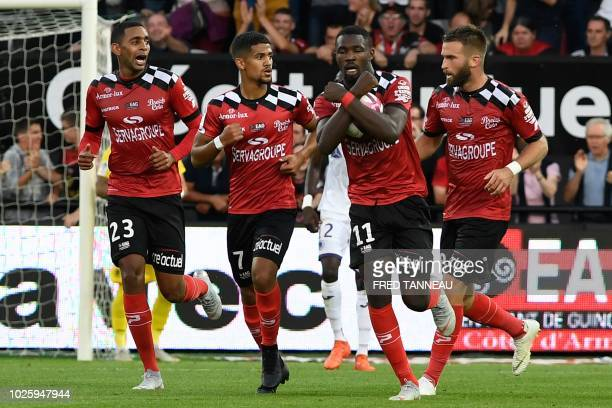 Guingamp's French forward Marcus Thuram celebrates after scoring a goal during the French L1 football match between Guingamp and Toulouse on...