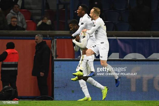 Guingamp's French forward Marcus Thuram celebrates with teammates after scoring a penalty kick during the French League Cup quarter-final football...