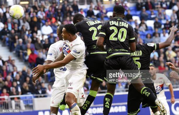 Guingamp's French forward Marcus Thuram heads the ball and scores during the French L1 football match Lyon vs Guingamp , on September 10, 2017 at the...
