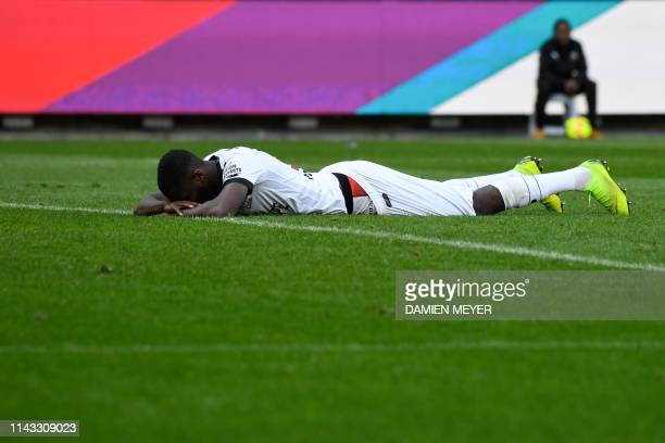 Guingamp's French forward Marcus Thuram reacts after missing a goal during the French Ligue 1 football match between Stade Rennais FC and Guingamp...