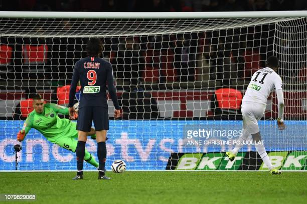 Guingamp's French forward Marcus Thuram shoots and scores a penaty kick past Paris SaintGermain's French goalkeeper Alphonse Areola during the French...