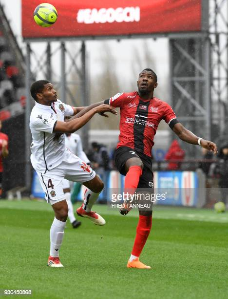 Guingamp's French forward Marcus Thuram vies against Nice's Brasilian defender Santos Marlon during the French L1 football match Guingamp against...