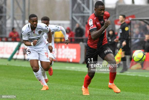 Guingamp's French forward Marcus Thuram vies against Nice's French midfielder Wylan Cyprien during the French L1 football match Guingamp against Nice...