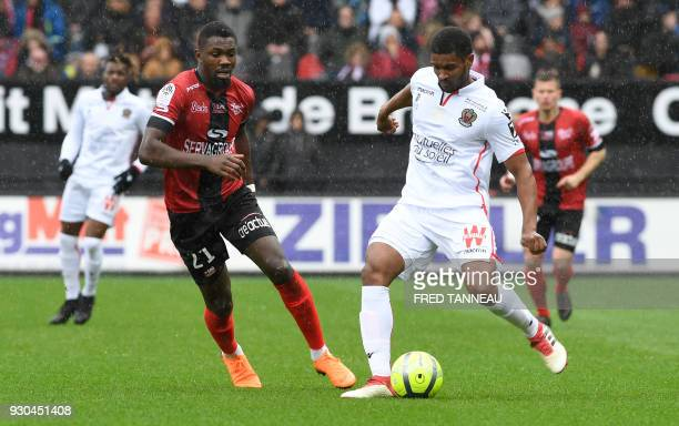 Guingamp's French forward Marcus Thuram vies for the ball against Nice's Brazilian defender Santos Marlon during the French L1 football match...