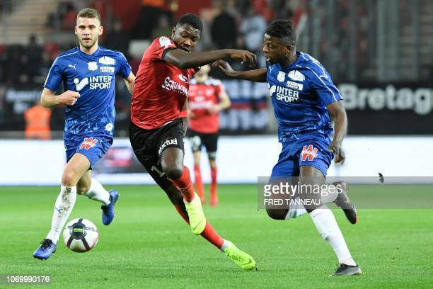 Guingamp's French forward Marcus Thuram vies with Amien's midfielder Eddy Gnahore during the French L1 football match between En Avant Guingamp and...