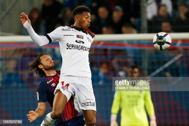 Guingamp's French forward Nathael Julan vies for the ball with Caen's French defender Paul Baysse during the French L1 football match between Caen...