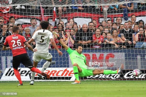 Guingamp's French forward Nolan Roux scores to Paris Saint-Germain's Italian goalkeeper Gianluigi Buffon during the French L1 football match between...