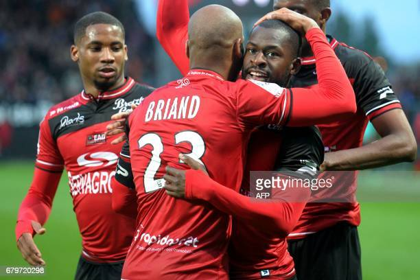 Guingamp's French forward Yannis Salibur is congratulated by his teammates after scoring a goal during the French L1 football match between Guingamp...