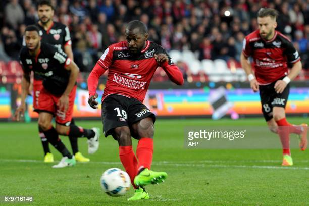 Guingamp's French forward Yannis Salibur scores a penalty during the French L1 football match between Guingamp and Dijon on May 6, 2017 at the...
