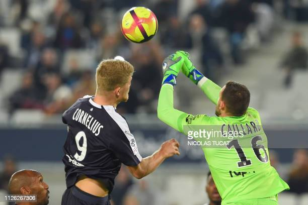 Guingamp's French goalkeeper MarcAurele Caillard fights for the ball with Bordeaux's Danish forward Andreas Cornelius during the French L1 football...