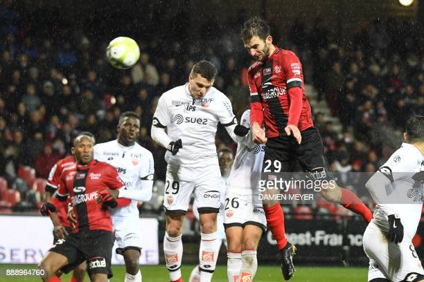 Guingamp's French midfielder Christophe Kerbrat heads the ball and scores a goal during the French L1 football match Guingamp vs Dijon on December 9,...