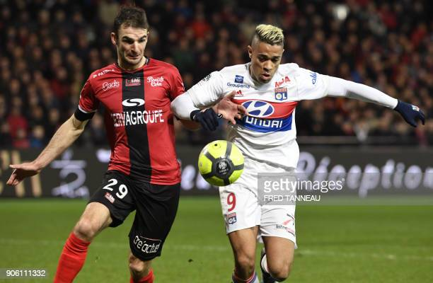 Guingamp's French midfielder Christophe Kerbrat vies Lyon's SpanishDominican forward Mariano Diaz during the French L1 football match between...