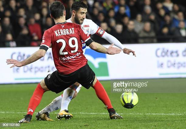 Guingamp's French midfielder Christophe Kerbrat vies Lyon's French midfielder Nabil Fekir during the French L1 football match Guingamp against Lyon...