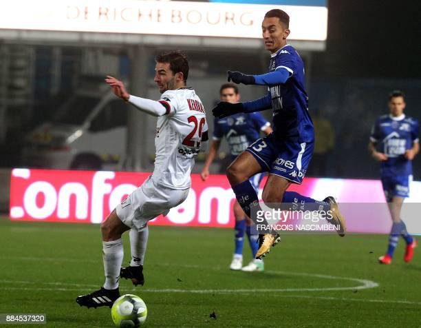 Guingamp's French midfielder Christophe Kerbrat vies with Troyes' midfielder SaîfEddine Khaoui during the French L1 football match between Troyes and...