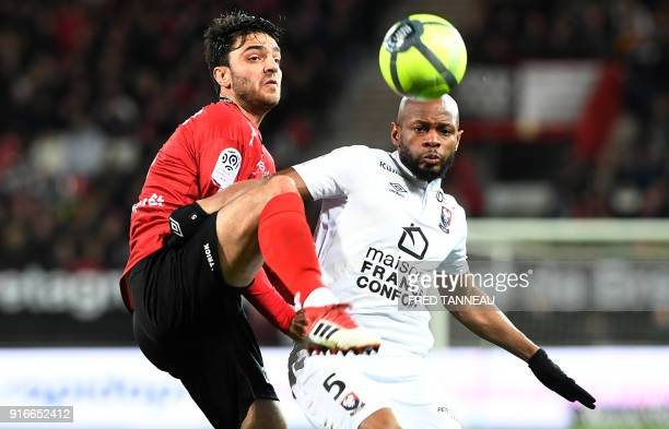 Guingamp's French midfielder Clement Grenier vies Caen's FrenchGuinean midfielder Baissama Sankoh during the French L1 football match between...
