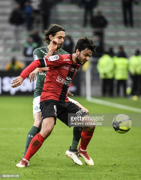 Guingamp's French midfielder Clement Grenier vies with SaintEtienne's Serbian defender Neven Subotic during the French L1 football match between AS...