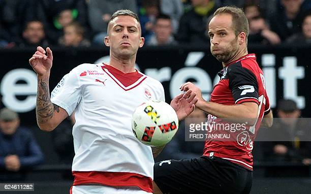 Guingamp's French midfielder Etienne Didot challenges Bordeaux's French forward Jeremy Menez during the French L1 football match between Guingamp and...