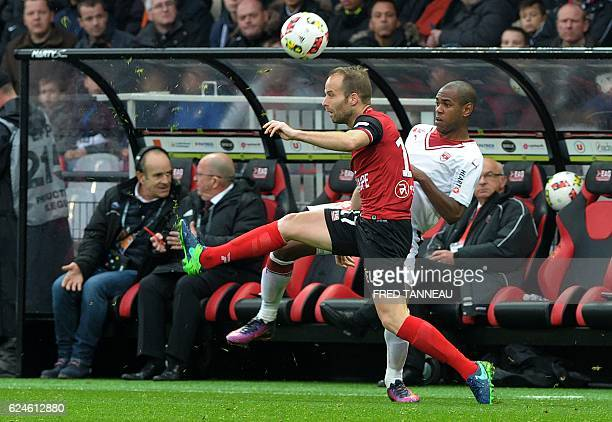 Guingamp's French midfielder Etienne Didot challenges Bordeaux's Uruguyan forward Diego Rolan during the French L1 football match between Guingamp...