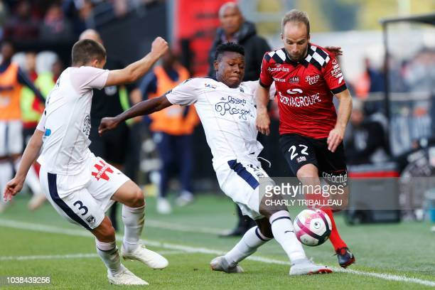Guingamp's French midfielder Etienne Didot vies for the ball with Bordeaux's Spanish defender Sergi Palencia and Bordeaux's Nigerian forward Samuel...