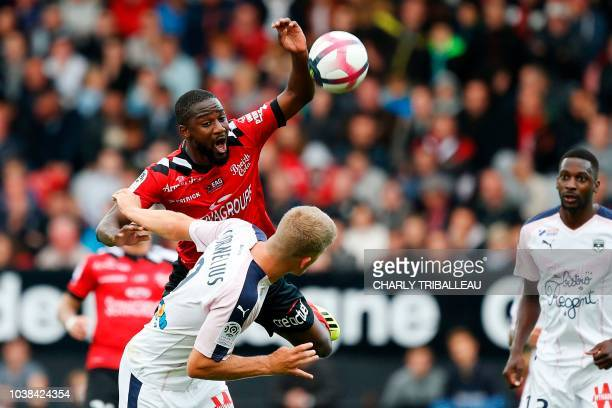 Guingamp's French midfielder Guessouma Fofana vies for the ball with Bordeaux's Danish forward Andreas Cornelius during the French L1 football match...