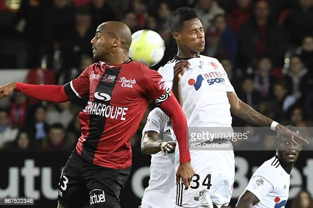 Guingamp's French midfielder Jimmy Briand vies with Amien's SouthAfrican midfielder Bongani Zungu during the French L1 football match between...