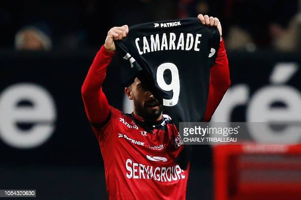 Guingamp's French midfielder Nicolas Benezet celebrates after scoring a goal during the French L1 football match between Guingamp and Strasbourg on...