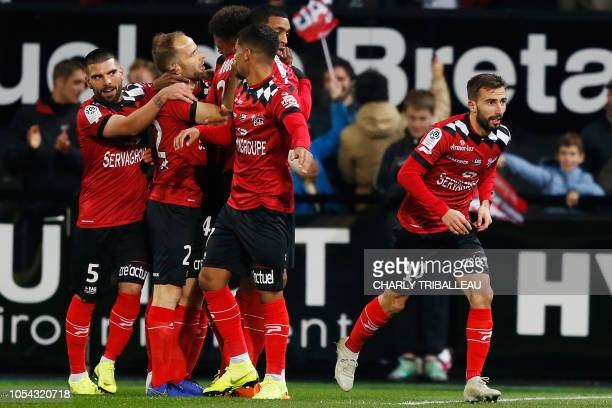Guingamp's French midfielder Nicolas Benezet celebrates with teammates after scoring a goal during the French L1 football match between Guingamp and...