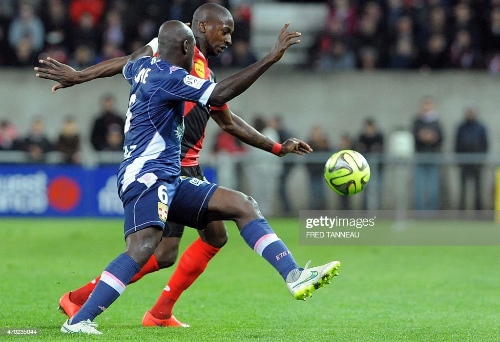 Guingamp's French midfielder Younousse Sankhare (R) vies with Evian's Ivorian Burkinabese midfielder Djakaridja Kone during the French L1 football match between Guingamp and Evian on April 18, 2015 at the Roudourou stadium in Guingamp, western of France.