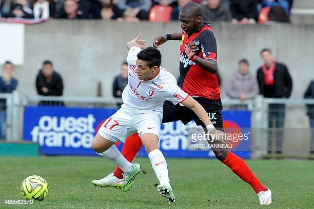 Guingamp's French midfielder Younousse Sankhare vies with Lille's Portuguese midfielder Marco Lopes during the French L1 football match between...