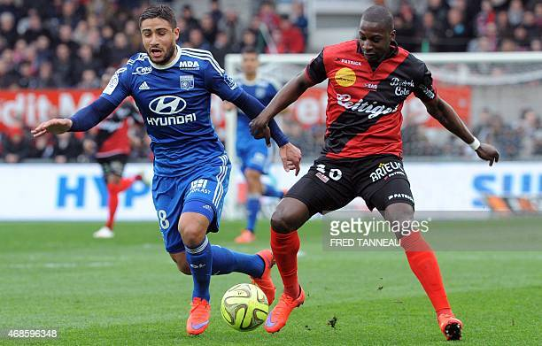 Guingamp's French midfielder Younousse Sankhare vies with Lyon's French forward Alexandre Lacazette during the French L1 football match between...