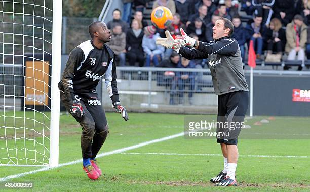 Guingamp's goalkeeper Guy Roland N'dy Assembe warms up prior to the French L1 football match between Guingamp and Paris SaintGermain on January 25...