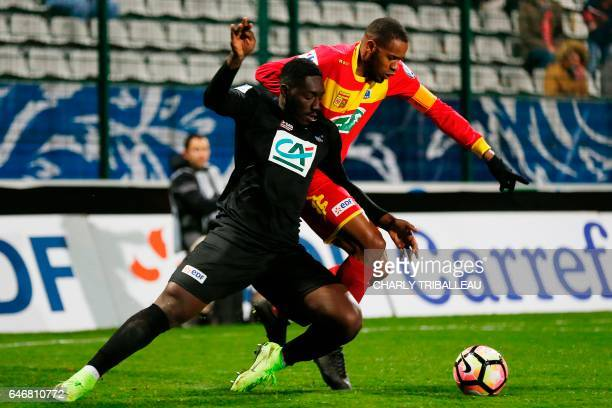Guingamp's midfielder Alexandre Mendy vies with Quevilly Rouen's french defender William Sery during the French Cup football match between Quevilly...
