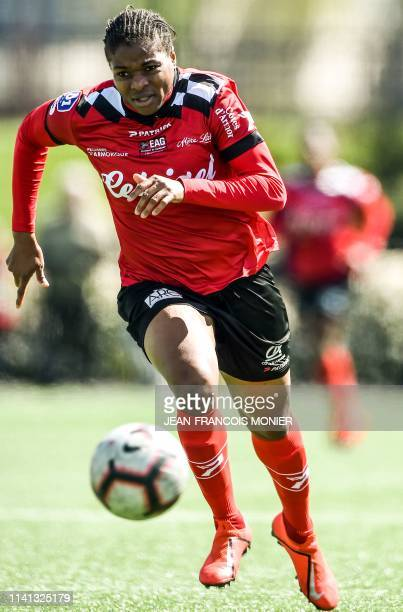 Guingamp's Nigerian forward Desire Oparanozie runs with the ball during a French women D1 football match between Guingamp and Paris Saint-Germain on...