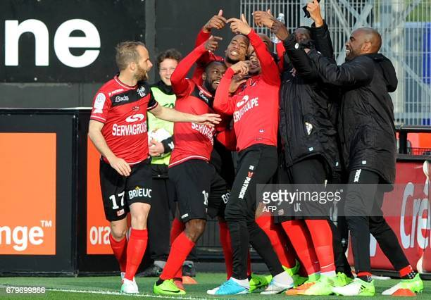 Guingamp's players celebrate after scoring a goal during the French L1 football match between Guingamp and Dijon on May 6, 2017 at the Roudourou...