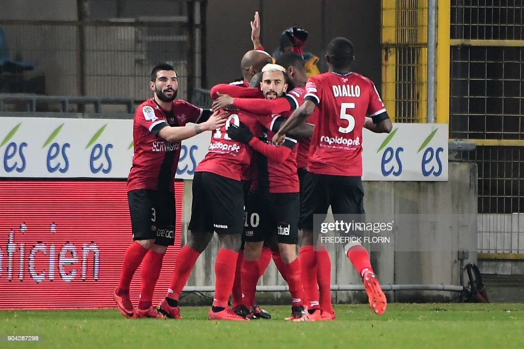 Guingamp's players celebrate after scoring a goal during the French L1 football match between Strasbourg (RCSA) and Guingamp (EAG) on January 12, 2018 at the Meinau stadium in Strasbourg, eastern France. /