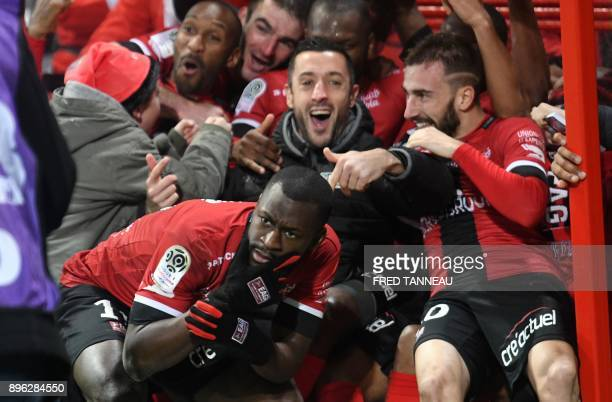Guingamp's players celebrate after scoring during the French L1 football match Guingamp against SaintEtienne December 20 2017 at the Roudourou...