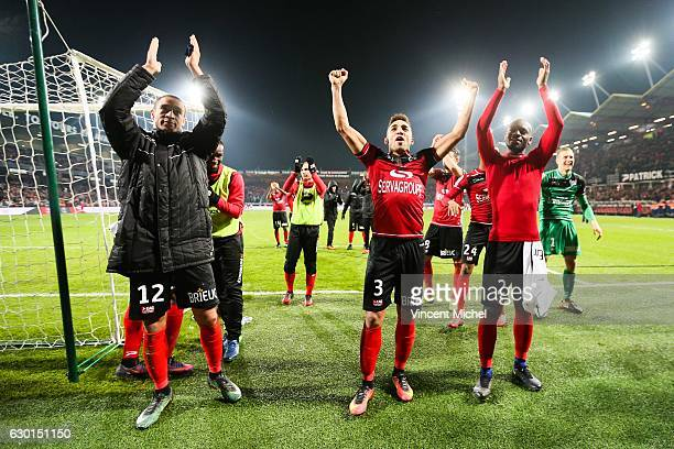 Guingamp's players celebrate with their fans after defeating Paris SG during the French Ligue 1 match between Guingamp and Paris Saint Germain at...