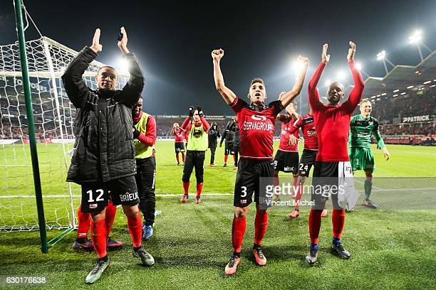 Guingamp's players celebrates with their fans at the end of the match during the French Ligue 1 match between Guingamp and Paris Saint Germain at...
