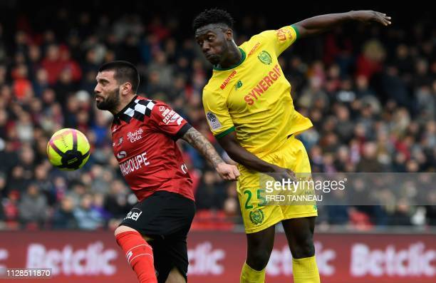 Guingamp's Portuguese defender Pedro Rebocho vies for the ball with Nantes' French defender Enock Kwateng during the French L1 football match between...