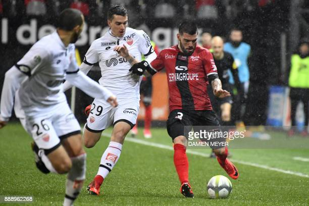 Guingamp's Portuguese defender Pedro Rebocho vies with Dijon's French forward Benjamin Jeannot during the French L1 football match between Guingamp...