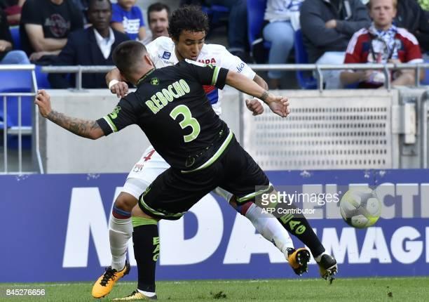 Guingamp's Portuguese defender Pedro Rebocho vies with Lyon's Brazilian defender Rafael da Silva during the French L1 football match Lyon vs Guingamp...